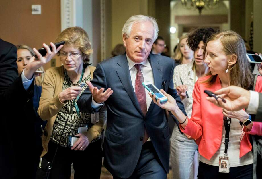 Sen. Bob Corker, R-Tenn., responds to questions after leaving a meeting with his colleagues as they continue working on the health-care legislation on Capitol Hill. Photo: Melina Mara / Washington Post   / The Washington Post