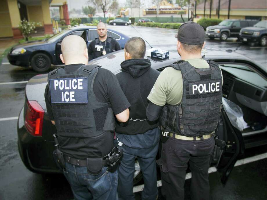 In this photo taken Feb. 7, 2017 and released by U.S. Immigration and Customs Enforcement, an arrest is made during a targeted enforcement operation conducted by U.S. Immigration and Customs Enforcement (ICE) aimed at immigration fugitives, re-entrants and at-large criminal aliens in Los Angeles. The Trump administration is wholesale rewriting the U.S. immigration enforcement priorities, broadly expanding the number of immigrants living in the U.S. illegally who are priorities for deportation, according to a pair of enforcement memos released Feb. 21, 2017. Photo: Charles Reed/U.S. Immigration And Customs Enforcement Via AP   / Public Domain Charles Reed/U.S. Immigration and Customs Enforcement
