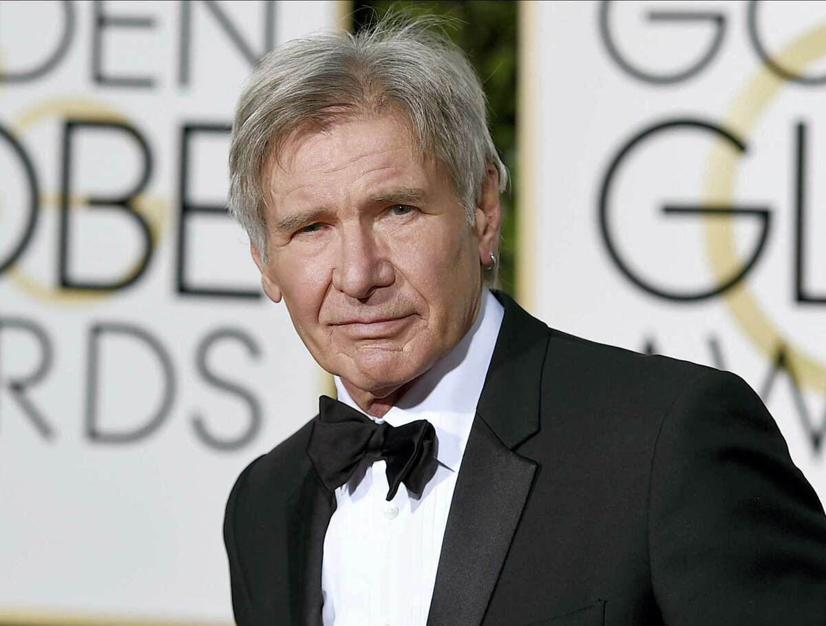 "In this Jan. 10, 2016, file photo, Harrison Ford arrives at the 73rd annual Golden Globe Awards in Beverly Hills, Calif. Newly released video shows a plane piloted by Ford mistakenly flying low over an airliner that was taxiing at a Southern California airport. The 45 seconds of video released Tuesday, Feb. 21, 2017, shows the 74-year-old ""Star Wars"" and ""Indiana Jones"" star's potentially serious mishap at John Wayne Airport in Orange County."