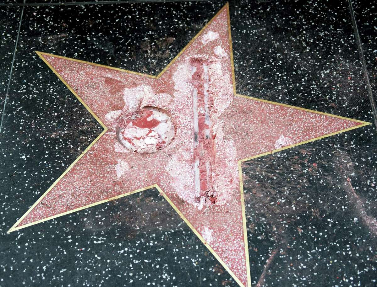 This Oct. 26, 2016, file photo shows the vandalized Hollywood Walk of Fame star of then-presidential candidate Donald Trump. An attorney for James Lambert Otis, who admitted causing the damage, says he pleaded no contest to felony vandalism Tuesday, Feb. 21, 2017. He was sentenced to three years of probation, 20 days of community labor and to pay $4,400 for the damage. (AP Photo/Richard Vogel, File)