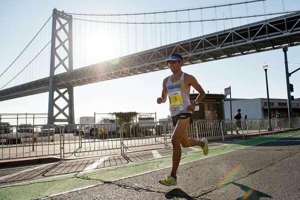 Jorge Maravilla passes under the Bay Bridge on his way to winning the 2017 San Francisco Marathon, in San Francisco, CA, on Sunday July 23, 2017.