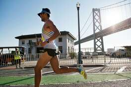 Jorge Maravilla passes under the Bay Bridge on his way to winning the 2017 San Francisco Marathon, in San Francisco, CA, on Sunday July 23, 2017.