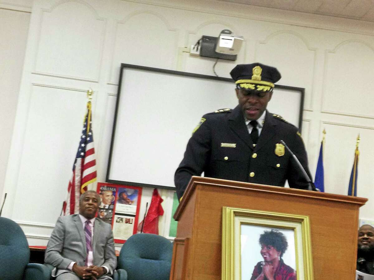 Keynote speaker New Haven Acting Police Chief Anthony Campbell speaks at the 21st Annual West Haven Black Heritage Celebration Wednesday in City Hall. He's flanked in the background by John Lewis, executive assistant to Mayor Ed O'Brien, left, and West Haven police officer Marcus Tavares, far right, who was honored along with the late West Haven Fire Department firefighter Ransford Smith Jr. as African-American Citizens of the Year.