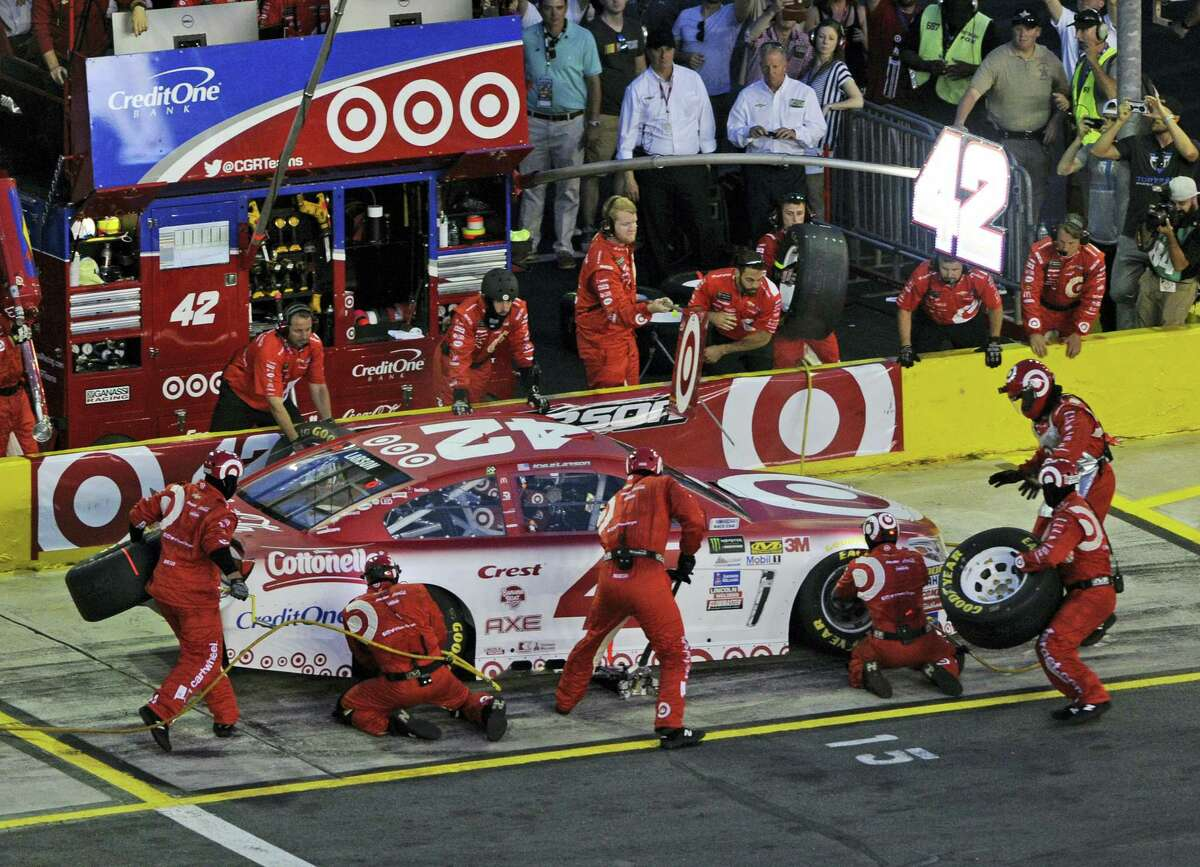 Crew members perform a pit stop on Kyle Larson's car during the NASCAR All-Star race on Saturday.