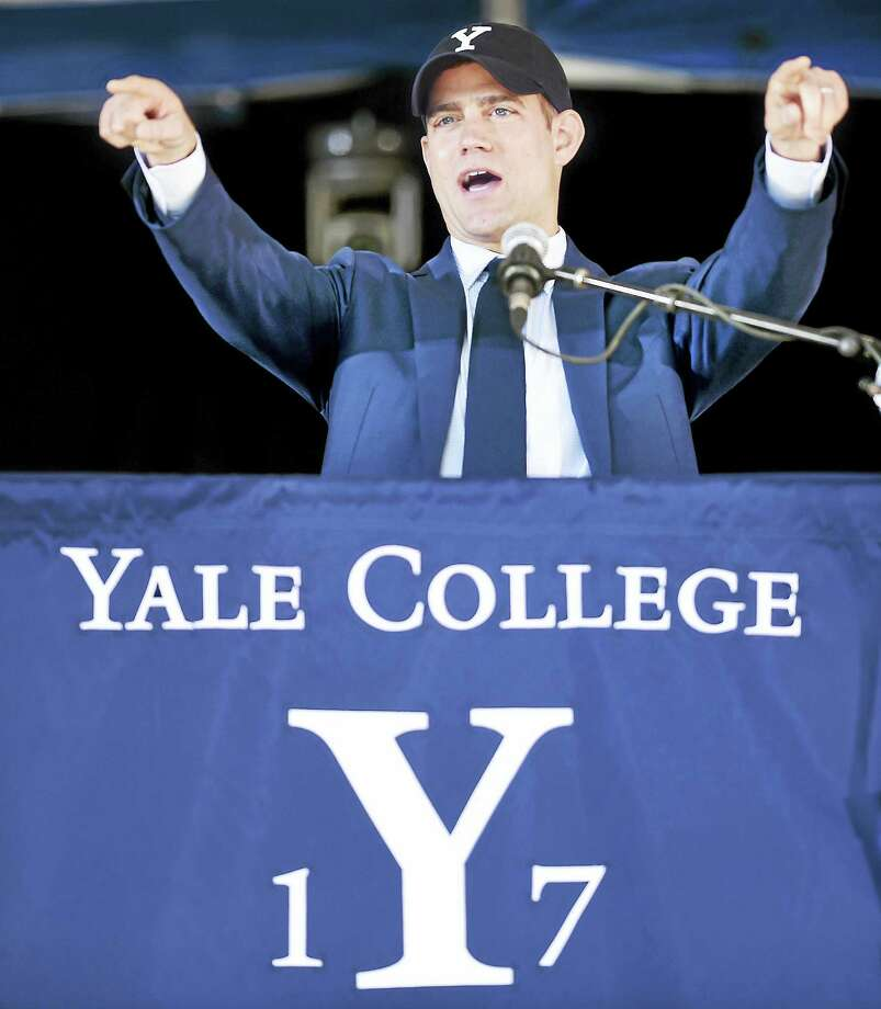 Theo Epstein, President of Baseball Operations for the Chicago Cubs, jokingly asks Yankees fans to exit Old Campus during his Class Day address at Yale on Sunday. Photo: Arnold Gold — Register