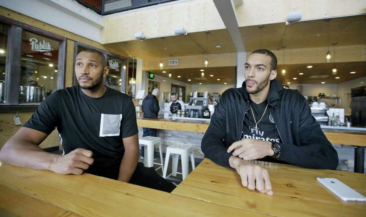 Ini this Jan. 12, 2017 photo, Utah Jazz's Boris Diaw, left, and Rudy Gobert look on during an interview, in Salt Lake City. Diaw and Gobert have known each other for years and were members of the French national team in the Rio Olympics. Their comfort level is a significant reason the Jazz are in the thick of the playoff race heading down the stretch after the All-Star break. (AP Photo/Rick Bowmer)