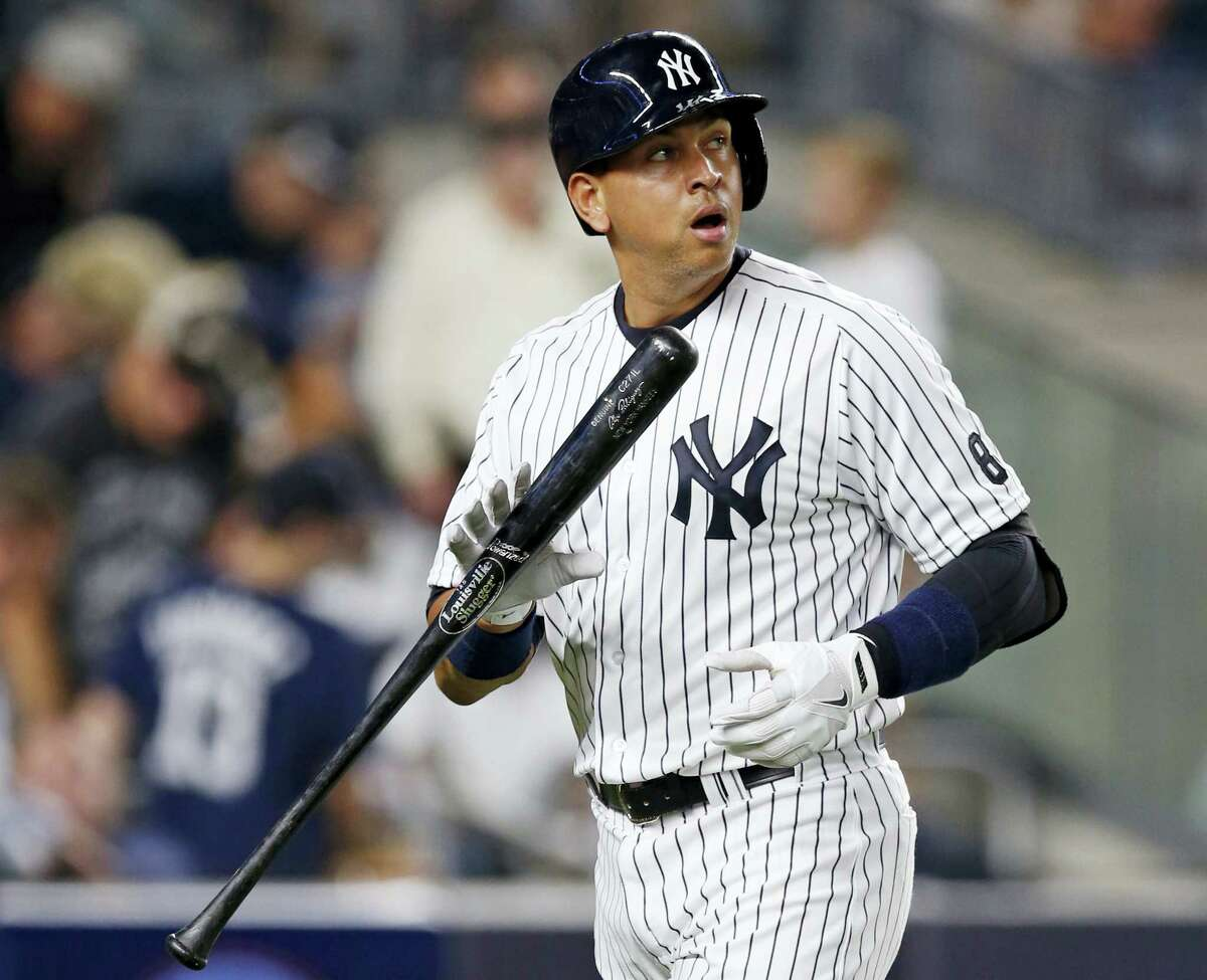 In this Aug. 12, 2016 file photo, New York Yankees designated hitter Alex Rodriguez reacts after striking out swinging against Tampa Bay Rays at Yankee Stadium in New York, his final game as a player. On his first day as a New York Yankees spring training guest instructor, 41-year-old Alex Rodriguez maintained he will not attempt a comeback as a player.