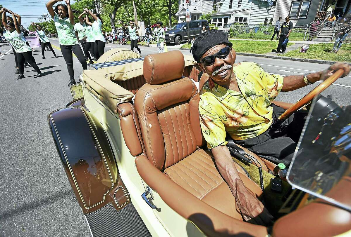 William Bowens drives his 1929 Mercedes Benz down Dixwell Avenue in the 2017 Freddie Fixer parade Sunday.