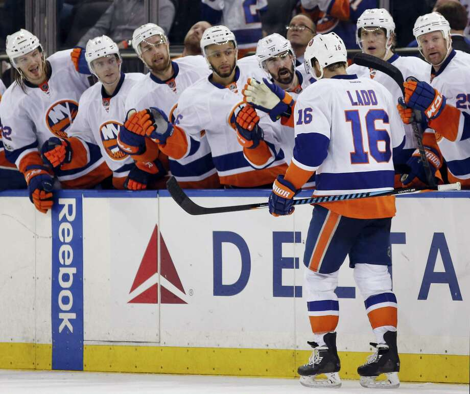 New York Islanders teammates greet left wing Andrew Ladd (16) who scored the game-winning goal in the third period of an NHL hockey game against the New York Rangers at Madison Square Garden in New York, Wednesday, March 22, 2017. The Islanders defeated the Rangers 3-2. (AP Photo/Kathy Willens) Photo: AP / AP