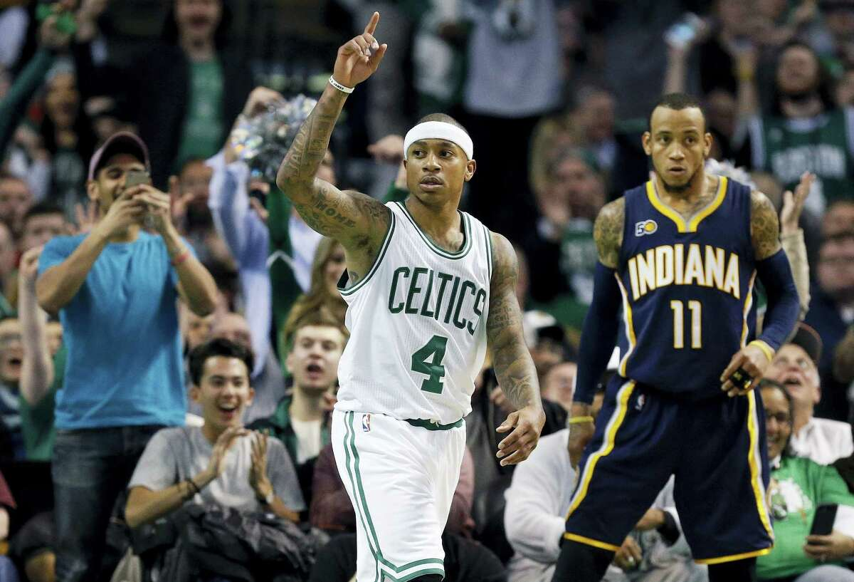 Boston Celtics' Isaiah Thomas (4) reacts beside Indiana Pacers' Monta Ellis (11) after scoring during the fourth quarter of an NBA basketball game in Boston, Wednesday, March 22, 2017. The Celtics won 109-100. (AP Photo/Michael Dwyer)