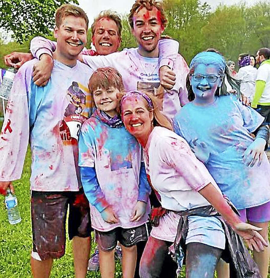 Runners and walkers were covered in color, from head to toe, in the Lifelinx/DAY 5K Nick Kruczek Color Run/Walk. Front row from left are Teagan Kruczek, Sue Kruczek and Haley Kruczek and back row from left are Matt Swicki, Kyle Kruczek and Sean Langrieger. Photo: Contributed Photo