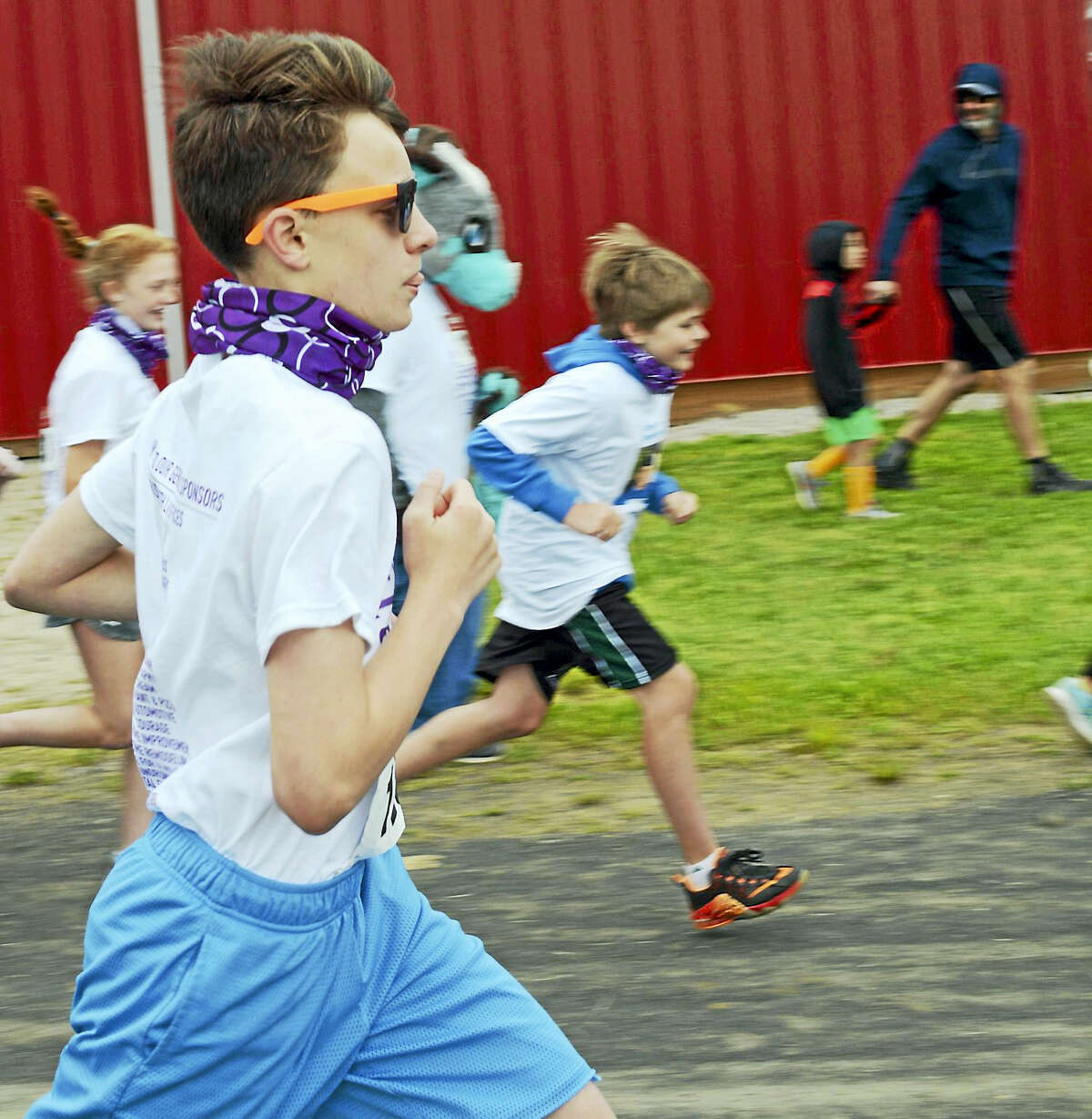 Photo by Jack TempletonOn your mark...runners go! Purple bandannas were worn by walkers and runners alike.