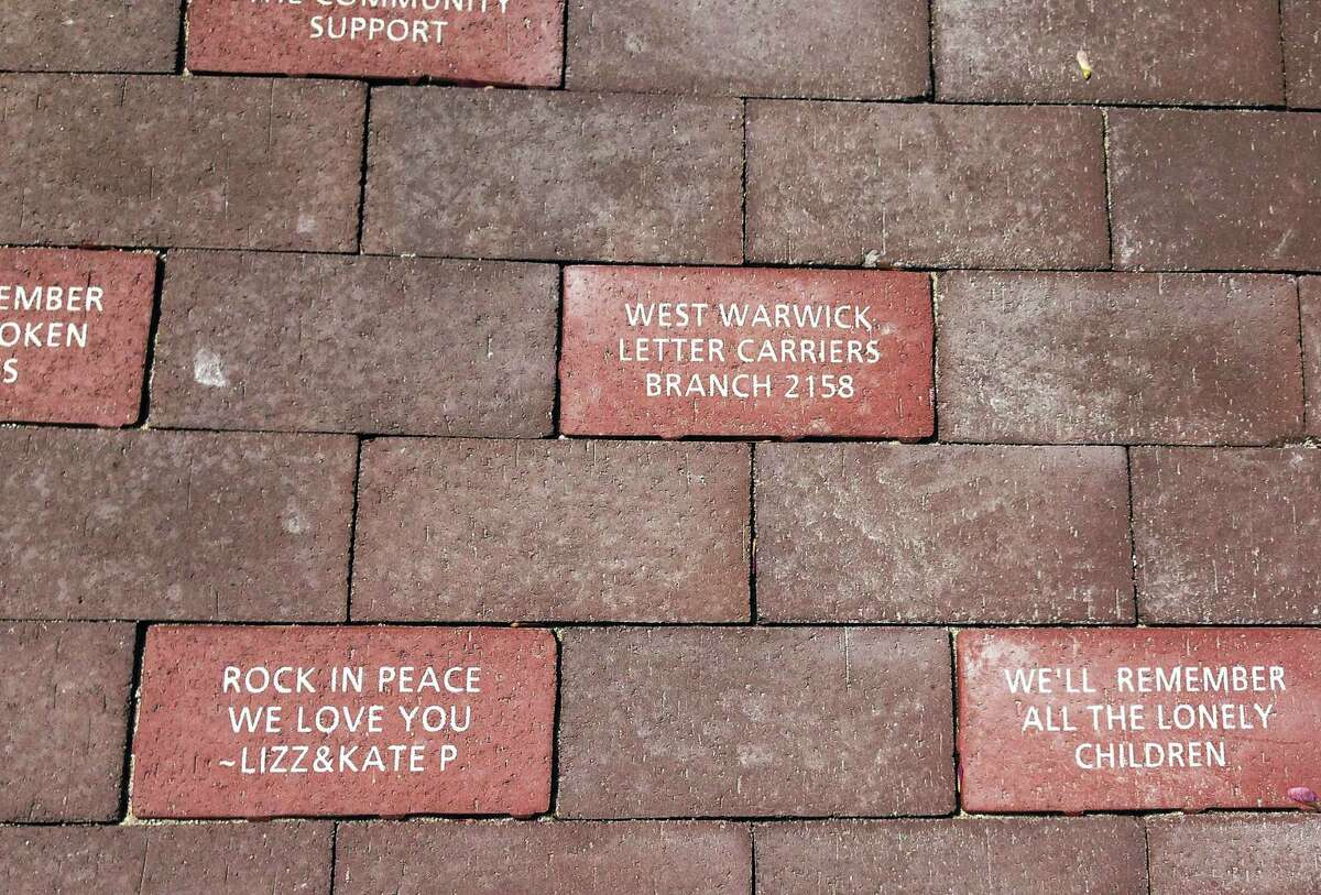 Bricks in a walkway at a memorial in West Warwick, R.I., on Friday, May 19, 2017, honor victims of The Station nightclub fire that killed 100 and injured more than 200 people in 2003. The memorial is scheduled to open during a ceremony Sunday. (AP Photo/Michelle R. Smith)