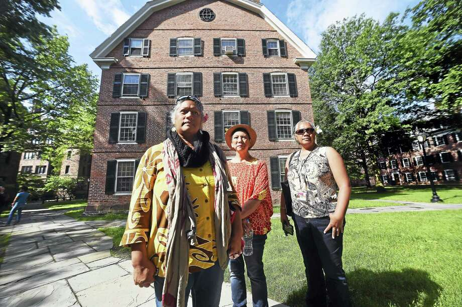 From left, Cynthia Hoomanawanui Akinmsu along with her cousin, Deborah Liikapeka Lee, and sister, Ka'ila Hoomanawanui Williams, of Hawaii are photographed in front of Connecticut Hall on Yale University's Old Campus in New Haven Tuesday. The three are descendants of Henry Opukaha'ia. Photo: Arnold Gold/Hearst Connecticut Media