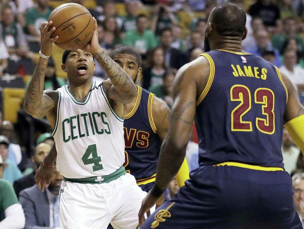 Celtics guard Isaiah Thomas (4) prepares to shoot as LeBron James defends.