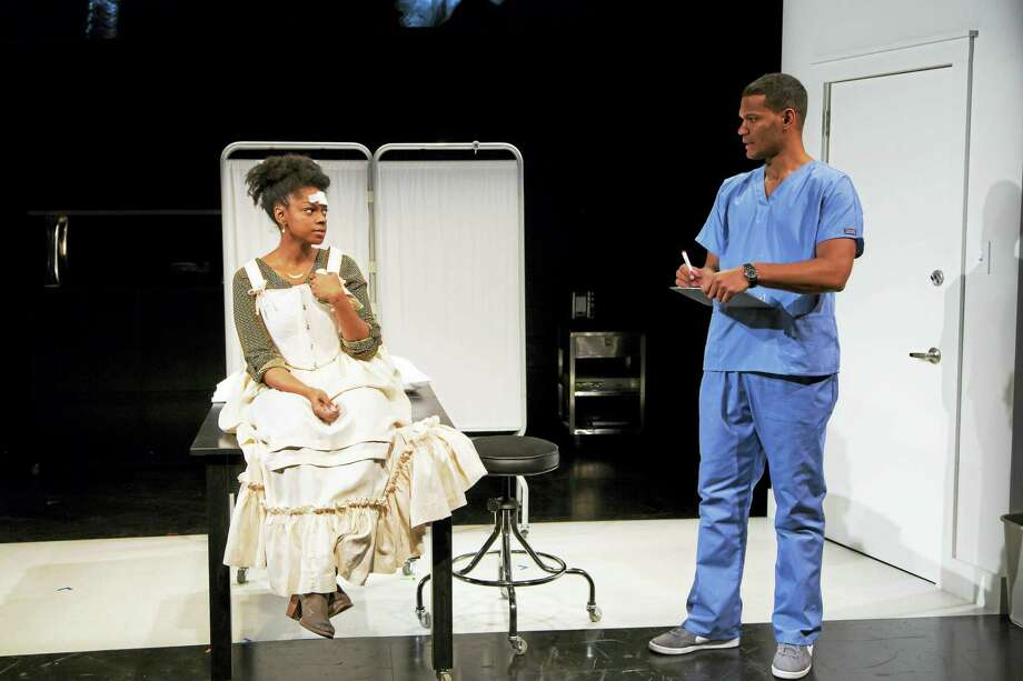 """Tiffany Nichole Greene and Sullivan Jones as patient and doctor in """"Smart People."""" Photo: Photo Courtesy Of T. Charles Erickson — Long Wharf Theatre   / T Charles Erickson"""