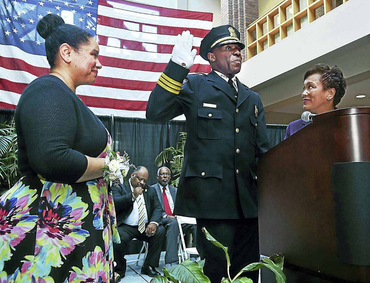 Mayor Toni Harp swears-in Anthony Campbell as chief of the New Haven Police Department Tuesday at New Haven City Hall. At left is his wife, Stephanie.