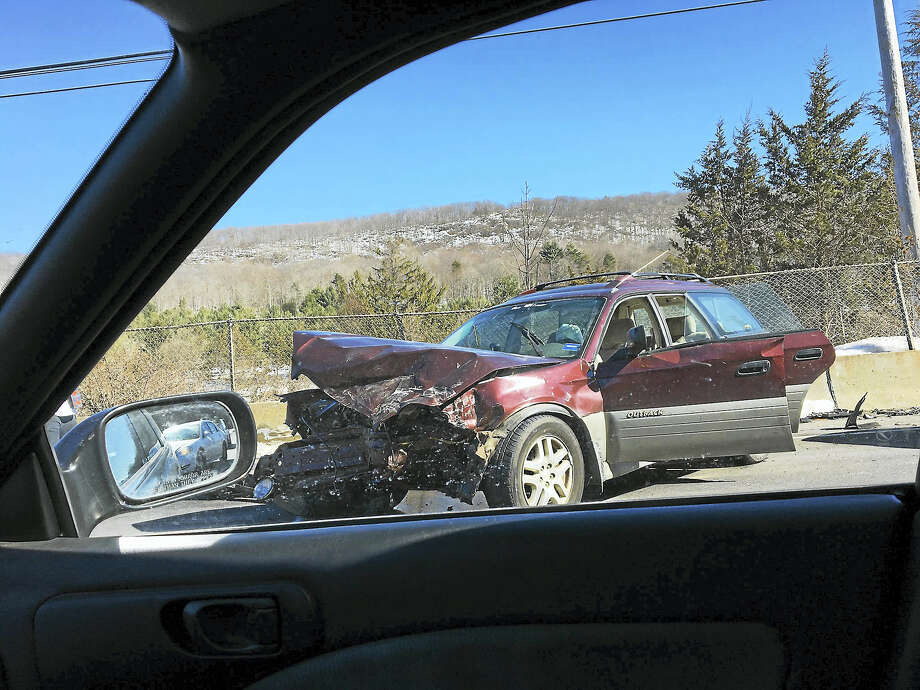 Emergency officials respond to a two-car crash in Bethany on Thursday afternoon. Photo: Contributed Photos