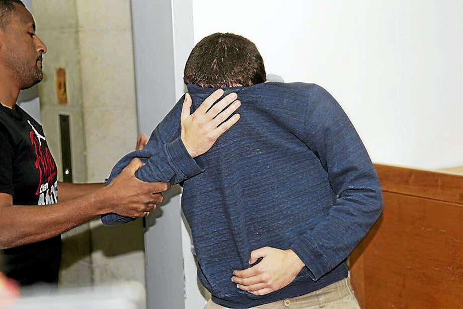 A 19-year-old dual U.S.-Israeli citizen covers his face as he is brought to court in Rishon Lezion, Israel, Thursday, March 23, 2017. Israeli police said they have arrested a Jewish Israeli man who is the prime suspect behind a wave of bomb threats against Jewish community centers and other institutions in the United States. The police withheld his identity. Photo: AP Photo/Nir Keidar    / Copyright 2017 The Associated Press. All rights reserved.