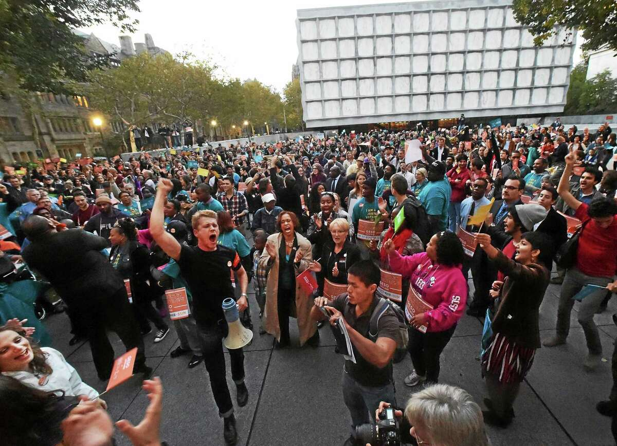 In this file photo, about 2,000 people at Yale University's Beinecke Plaza in front of Woodbridge Hall in October 2014 after marching from another rally on College Street near Elm Street in New Haven in support of GESO (Graduate Employees and Student Organization) at Yale University and its right to unionize.