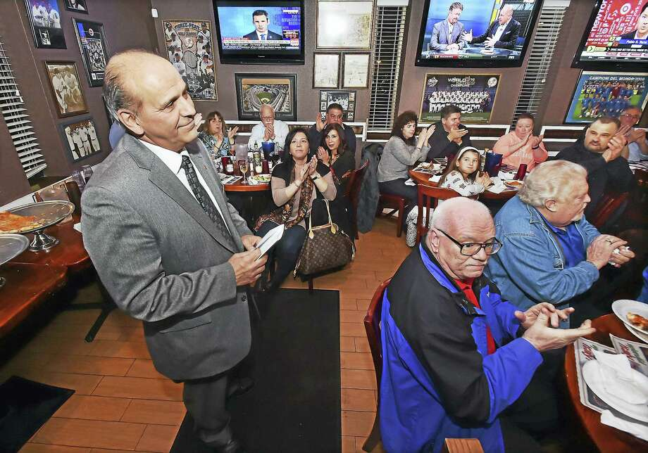 Derby Aldermanic President Carmen DiCenso, a former Derby High School football coach, announces his mayoral bid amid supporters at the Italian Pavilion restaurant Tuesday. DiCenso a Democrat, will challenge Derby Mayor Anita Dugatto, who has announced she will seek a third term. Photo: Catherine Avalone — New Haven Register   / Catherine Avalone/New Haven Register
