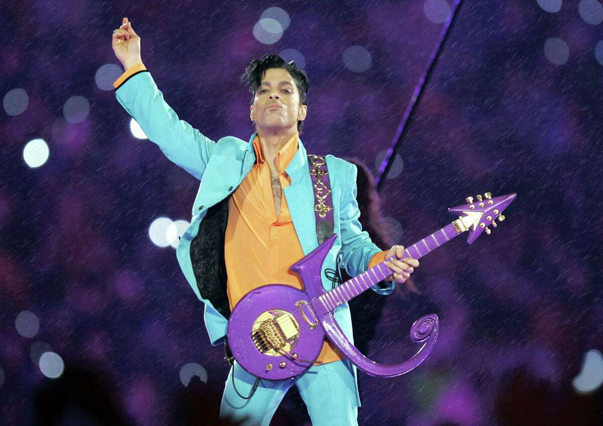 In this Feb. 4, 2007 photo, Prince performs during the halftime show at the Super Bowl XLI football game in Miami. Nearly a year after Prince died from an accidental drug overdose in his suburban Minneapolis studio and estate, investigators still haven't interviewed a key associate nor asked a grand jury to investigate potential criminal charges, according to an official with knowledge of the investigation.