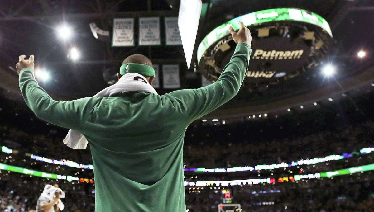Celtics guard Isaiah Thomas celebrates from the bench during a game earlier this season.