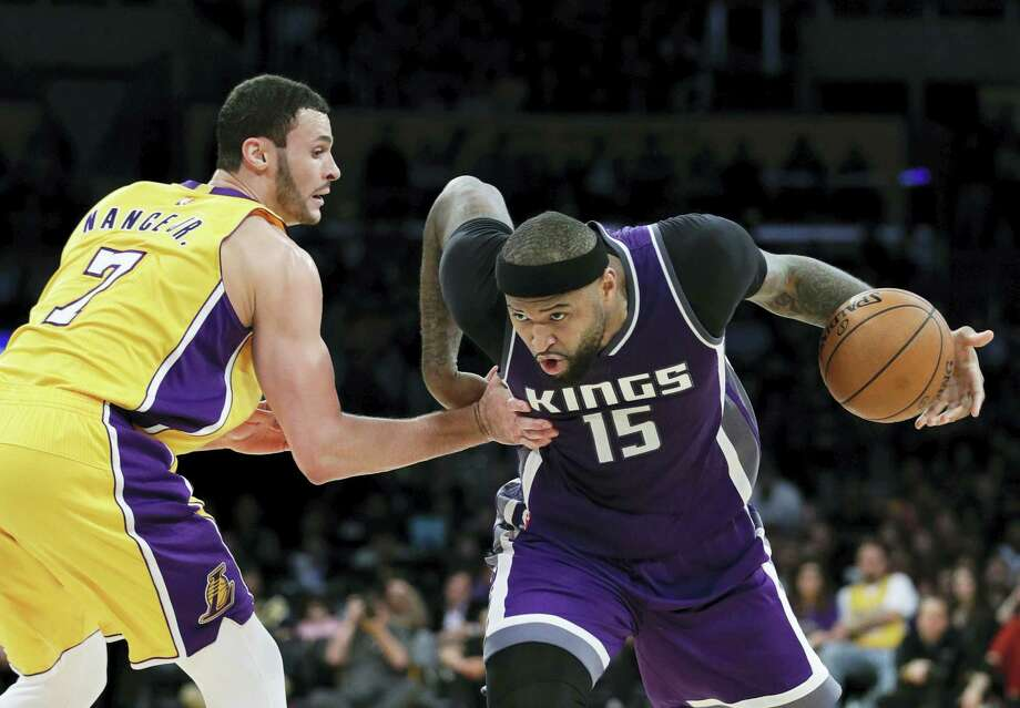 In this Feb. 14, 2017 photo, Sacramento Kings' DeMarcus Cousins, right, drives past Los Angeles Lakers' Larry Nance Jr. during the second half of an NBA basketball game in Los Angeles. A person familiar with the situation said Sunday that the Sacramento Kings have agreed to trade Cousins and Omri Casspi to the New Orleans Pelicans in exchange for Tyreke Evans, 2016 first-round draft pick Buddy Hield, Langston Galloway and first- and second-round draft picks this summer. Photo: AP Photo/Jae C. Hong, File   / Copyright 2017 The Associated Press. All rights reserved.