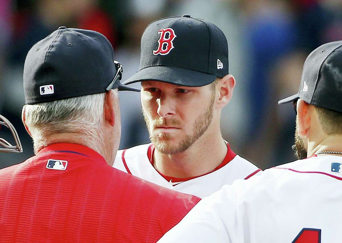 Chris Sale, center, talks to pitching coach Carl Willis during the third inning Saturday.