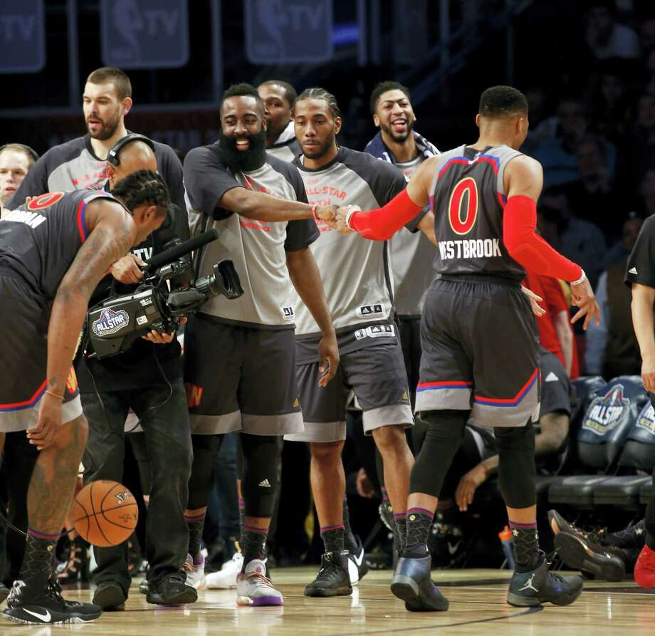Western Conference guard Russell Westbrook of the Oklahoma City Thunder (0) is greeted by teammates during the second half of the NBA All-Star basketball game in New Orleans on Feb. 19, 2017. Photo: AP Photo/Max Becherer   / FR 171354AP