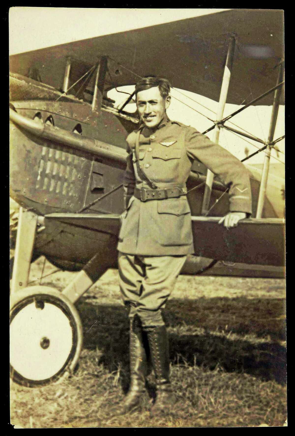 Lt. Gilbert Nelson Jerome with his biplane. He was shot down and killed by German forces in July 1918.