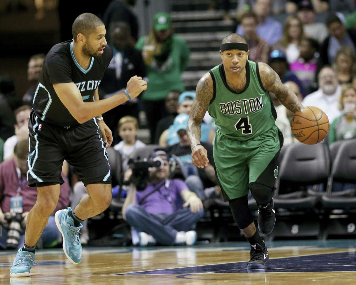 The Celtics' Isaiah Thomas (4) brings the ball up the court against the Hornets earlier this season.