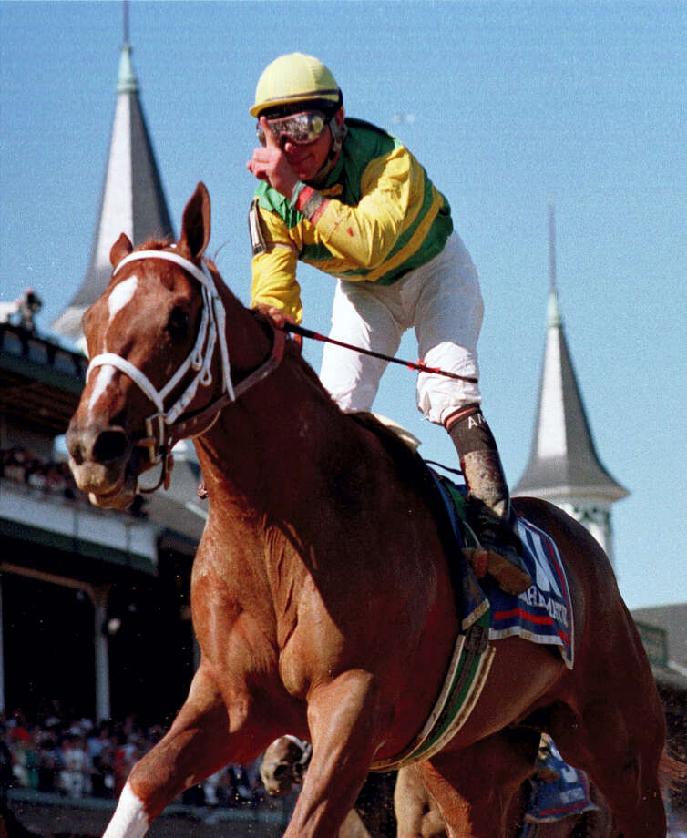 In this May 1, 1999 photo, jockey Chris Antley gestures aboard Charismatic after crossing the finish line to capture the 125th running of the Kentucky Derby in Louisville, Ky. Former Kentucky Derby and Preakness Stakes winner Charismatic has died at a thoroughbred retirement farm in Kentucky. Old Friends farm says the chestnut horse that won the first two legs of the Triple Crown in 1999 was found dead in his stall on Feb. 19, 2017. Photo: AP Photo/Al Berhman, File   / Copyright 2017 The Associated Press. All rights reserved.