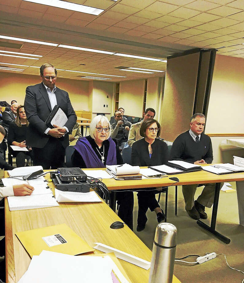 From left, attorneys Margery Shansky and Nancy Mendel testify at City Plan meeting Wednesday. Engineer James Rotondo is to their right. New Haven Chlor-Alkali Vice President Thomas Ross is standing behind Shansky. Photo: Mary O'Leary — New Haven Register
