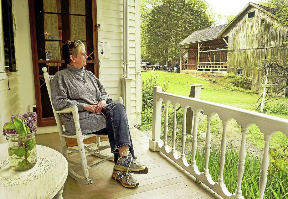 (Peter Hvizdak - New Haven Register)Beth Payne, Dudley Farm Museum Director, takes in a  view of the Big Barn from the porch of the Dudley Farm Museum farmhouse in Guilford Friday, May 12, 2017. The Dudley Farm is raising funds for phase 3 of the Big Barn Project, which is an effort to restore the physical integrity of the 200-year-old multipurpose barn and reinvent it as a museum. The Dudley Farm Museum sits on 10.5 acres and is owned by the Dudley Foundation. Photo: ©2017 Peter Hvizdak / ©2017 Peter Hvizdak