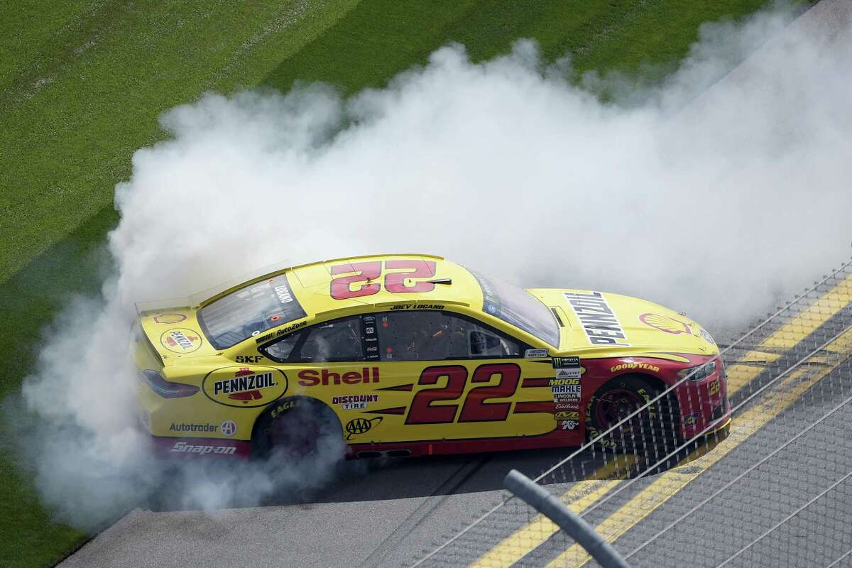 Joey Logano performs a burnout in front of the grandstands after winning the Clash at Daytona on Sunday.