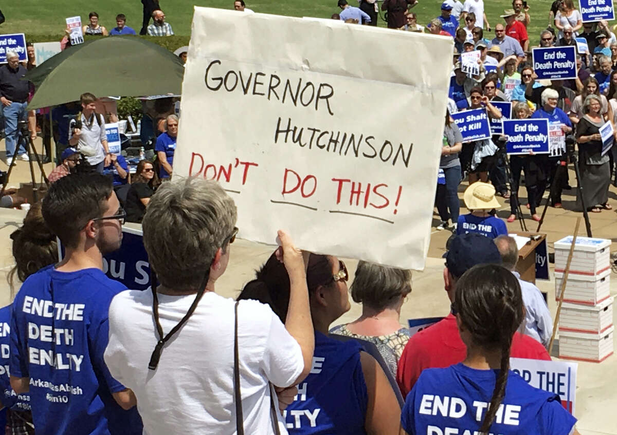 Protesters gather outside the state Capitol building on Friday in Little Rock, Ark., to voice their opposition to Arkansas' seven upcoming executions.