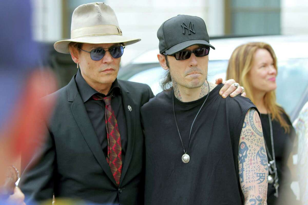 Actor Johnny Depp, left, stands with former Arkansas death row inmate Damien Echols, before speaking at a rally opposing Arkansas' upcoming executions, which are set to begin next week, on the front steps of the Capitol Friday in Little Rock, Ark.