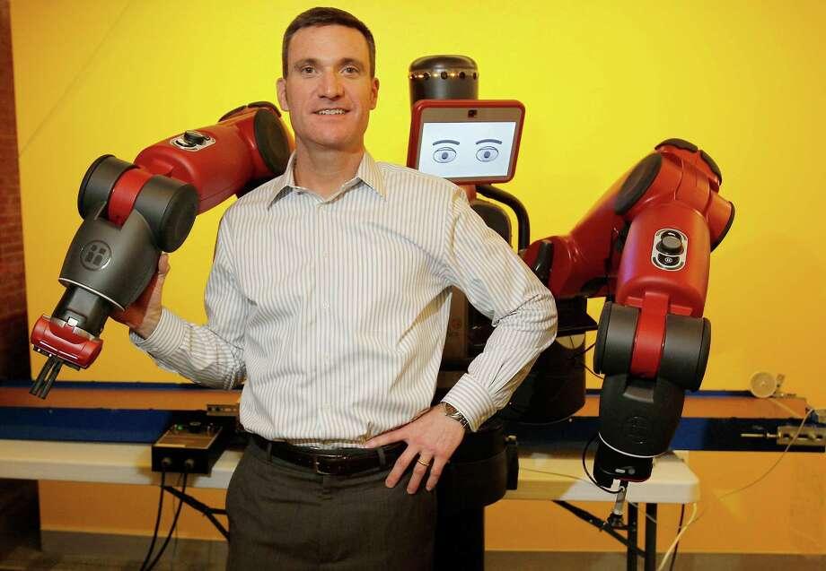 Jessica Rinaldi — The Washington Post   Scott Eckert, chief executive of the Boston-based Rethink Robotics, defends his industry against critics who decry robots as job killers. Photo: THE WASHINGTON POST / Jessica Rinaldi