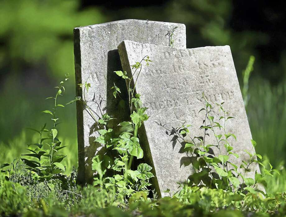 A broken gravestone at the State Street Cemetery at 2150 State Street in Hamden photographed Friday was established in 1799. Photo: Catherine Avalone - New Haven Register   / Catherine Avalone/New Haven Register