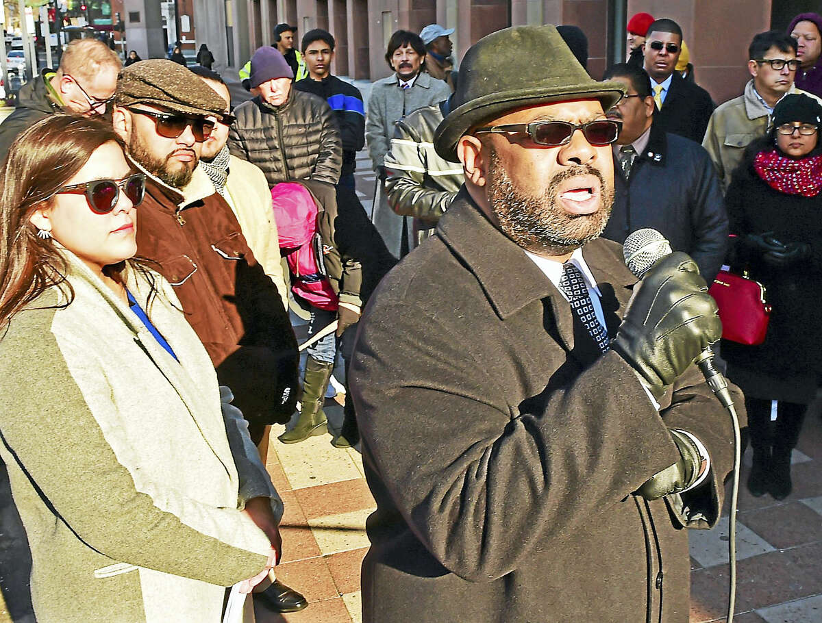 Attorney Michael Jefferson, who, in 1995, helped create New Haven's New Haven Police Department Civilian Review Board, speaks during a rally and press conference in front of New Haven City Hall.