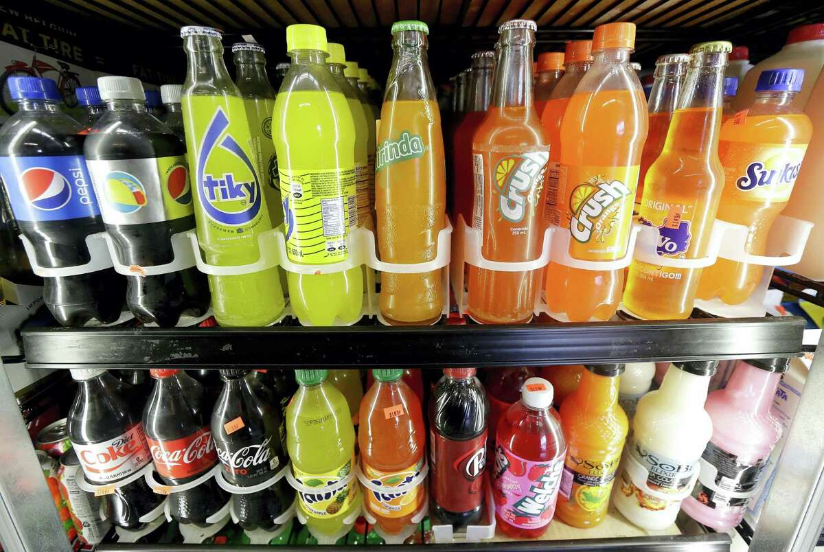 FILE - In this Wednesday, Sept. 21, 2016, file photo, soft drink and soda bottles are displayed in a refrigerator at El Ahorro market in San Francisco. After years of stamping out soda tax proposals with well-financed campaigns, Big Soda is suddenly finding itself up against bigger adversaries. In early November 2016, voters and lawmakers in five jurisdictions, including San Francisco and Chicago's Cook County, approved special taxes on sugary drinks, with advocates chalking up the streak of victories to a shift in public attitudes.
