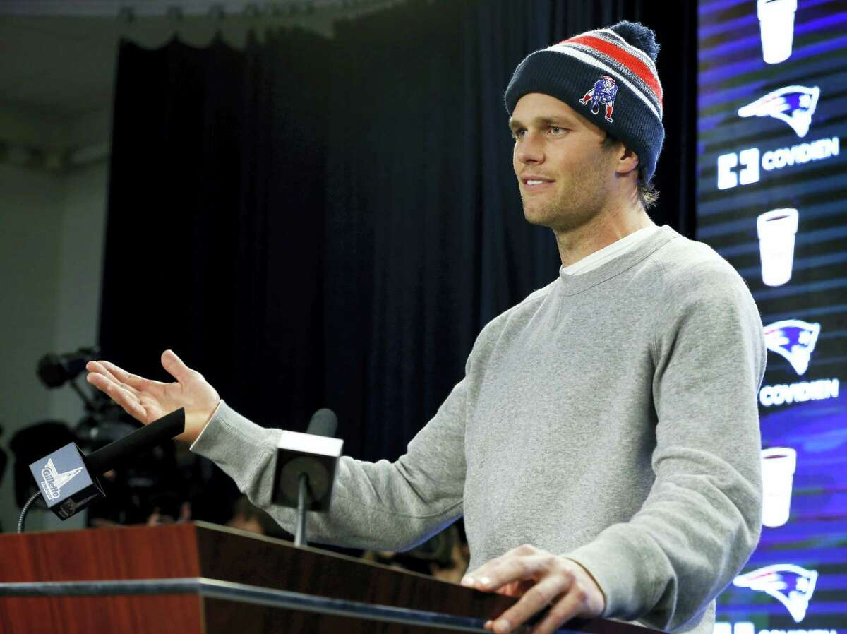 """FILE - In this Jan. 22, 2015, file photo, New England Patriots quarterback Tom Brady speaks at a news conference in Foxborough, Mass. Brady did not attend a 2015 celebration at the White House because of what the he insisted was a """"family commitment"""" but others speculated was because of some unflattering comments a spokesman for President Barack Obama made about the Deflategate scandal. (AP Photo/Elise Amendola, File)"""