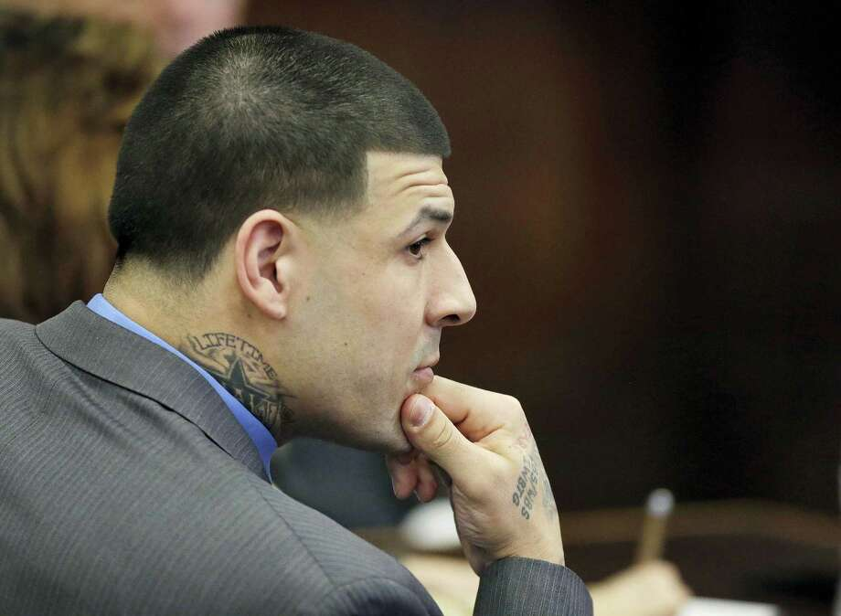 Former New England Patriots tight end Aaron Hernandez looks on during his double murder trial at Suffolk Superior Court Friday in Boston. Photo: Stephan Savoia — The Associated Press   / Pool, AP