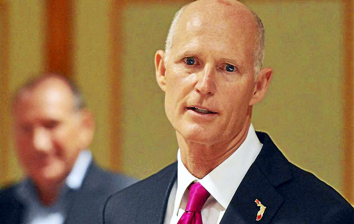 Republican Florida Gov. Rick Scott went to Norwalk on Monday to try to lure companies to move to his state.