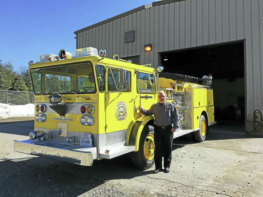 """Erwin """"Jay"""" Krause is offering to commemorate the service of deceased firefighters and EMTs by providing one last ride on his outfitted fire truck. Photo: Ben Lambert — The Register Citizen"""