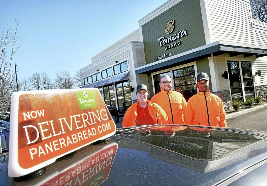 From left, Kristin Dehm, Joshua Webb and Daquan Fraser will be the first drivers for a food delivery service for Panera Bread in Milford beginning Thursday. Photo: Arnold Gold — New Haven Register