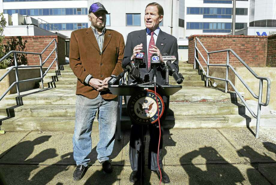 Elliott Storm of Milford, left, listens to U.S. Sen. Richard Blumenthal speak about Wi-Fi access for patients of the Veterans Affairs medical center in West Haven, in front of the hospital Monday. Photo: Arnold Gold — New Haven Register