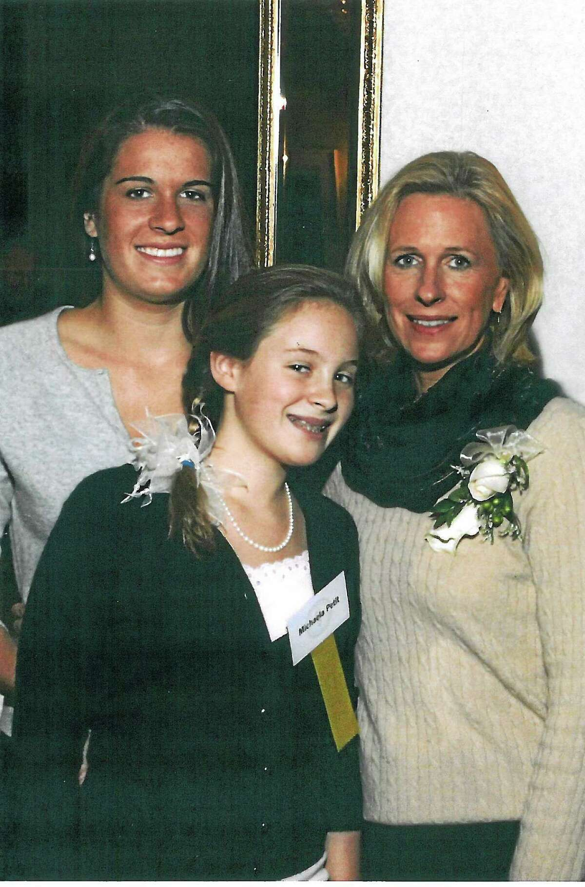 Hayley, left, and Michaela Petit and their mother, Jennifer Hawke-Petit