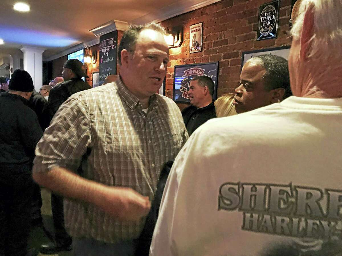 Former New Haven Battalion Chief Thomas Quinn, left, speaks to attendees of his retirement party Monday at The Trinity Bar & Restaurant in New Haven. Quinn retired after serving 31 years in the department.